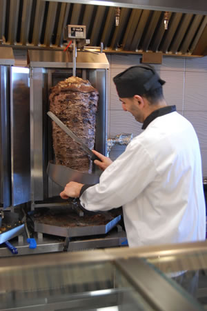 Slicing beef at Ottawa Shawarma